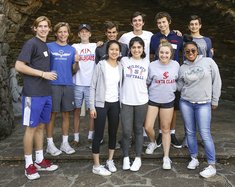 Students posing by a grotto at the Jesuit Retreat Center of Los Altos during a retreat